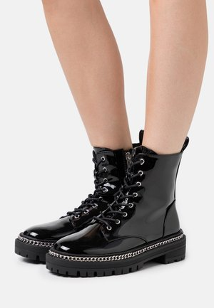 CARSON - Lace-up ankle boots - black