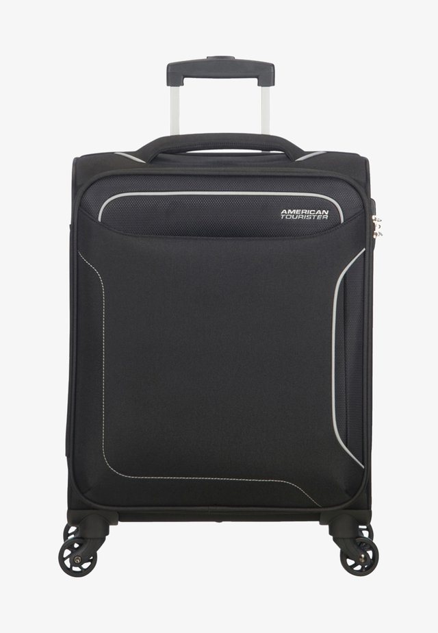 HOLIDAY HEAT - Wheeled suitcase - black