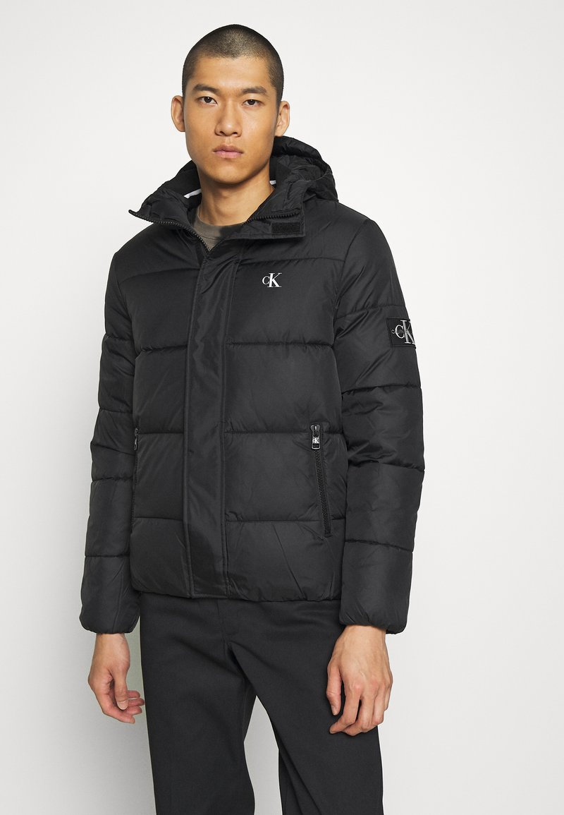Calvin Klein Jeans - HOODED PUFFER JACKET - Winter jacket - black
