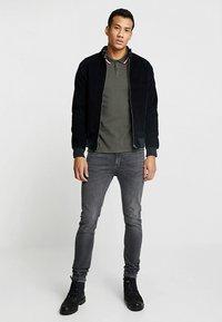 HARRINGTON - Polo shirt - kaki - 1