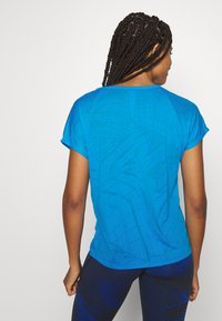 Reebok - BURNOUT TEE - Print T-shirt - blue - 2
