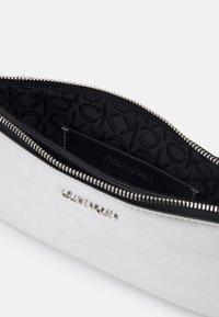 Calvin Klein - DOUBLE COMPARTMENT BODY  - Across body bag - silver - 2