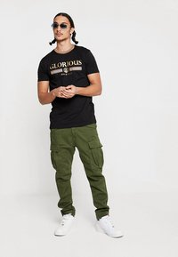 Alpha Industries - AIRMAN - Cargo trousers - dark oliv - 1