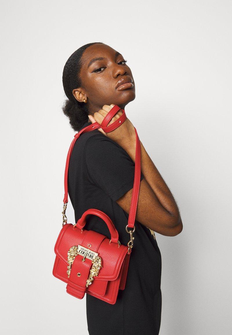 Versace Jeans Couture - MINI TOP HANDLE - Handbag - rosso