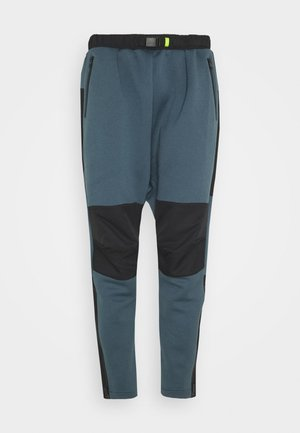 TECH - Tracksuit bottoms - legblu
