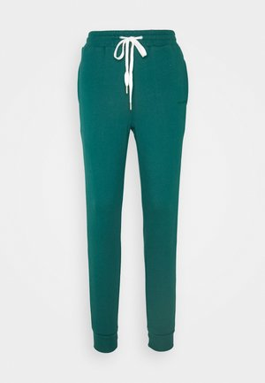 JOGGER - Tracksuit bottoms - pine green
