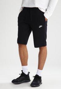 Nike Sportswear - CLUB - Tracksuit bottoms - schwarz/weiß - 0