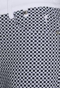 Golfino - RACING CAPRI - 3/4 sports trousers - optic white - 2