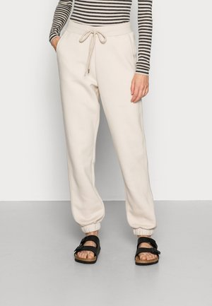 TROUSERS PERNILLE - Tracksuit bottoms - light beige
