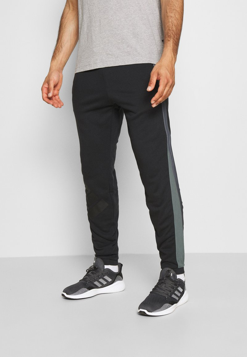 adidas Performance - BOSC - Tracksuit bottoms - black