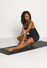 Nike Performance - YOGA LUXE JUMPSUIT - Turnpak - black - 1