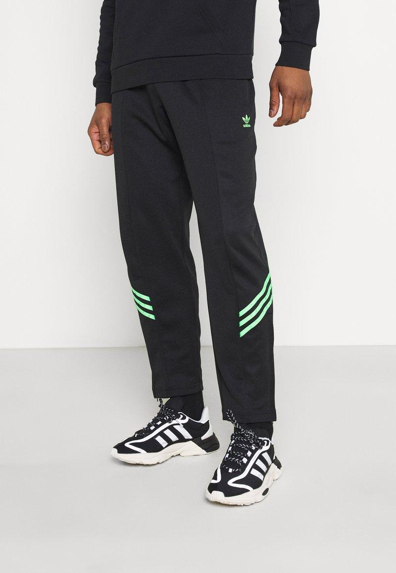 adidas Originals - TRACK PANT UNISEX - Tracksuit bottoms - black/shock lime