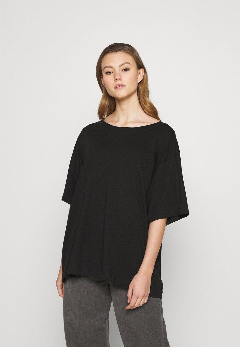 Weekday - REBECCA - T-shirts - black