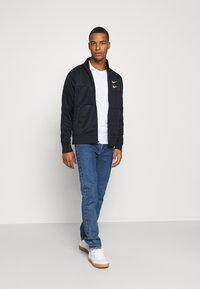 Nike Sportswear - Training jacket - black/gold foil - 1