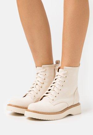 KURRT - Platform ankle boots - offwhite
