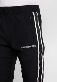 Calvin Klein Jeans - SIDE STRIPE TRACK PANT - Tracksuit bottoms - black - 3