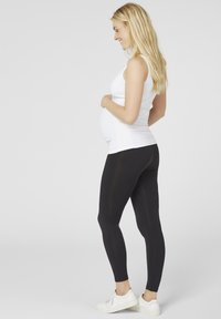 MAMALICIOUS - MLTIA JEANNE - Leggings - Trousers - black - 2