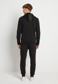 HUGO - DINORO - veste en sweat zippée - black/gold - 2
