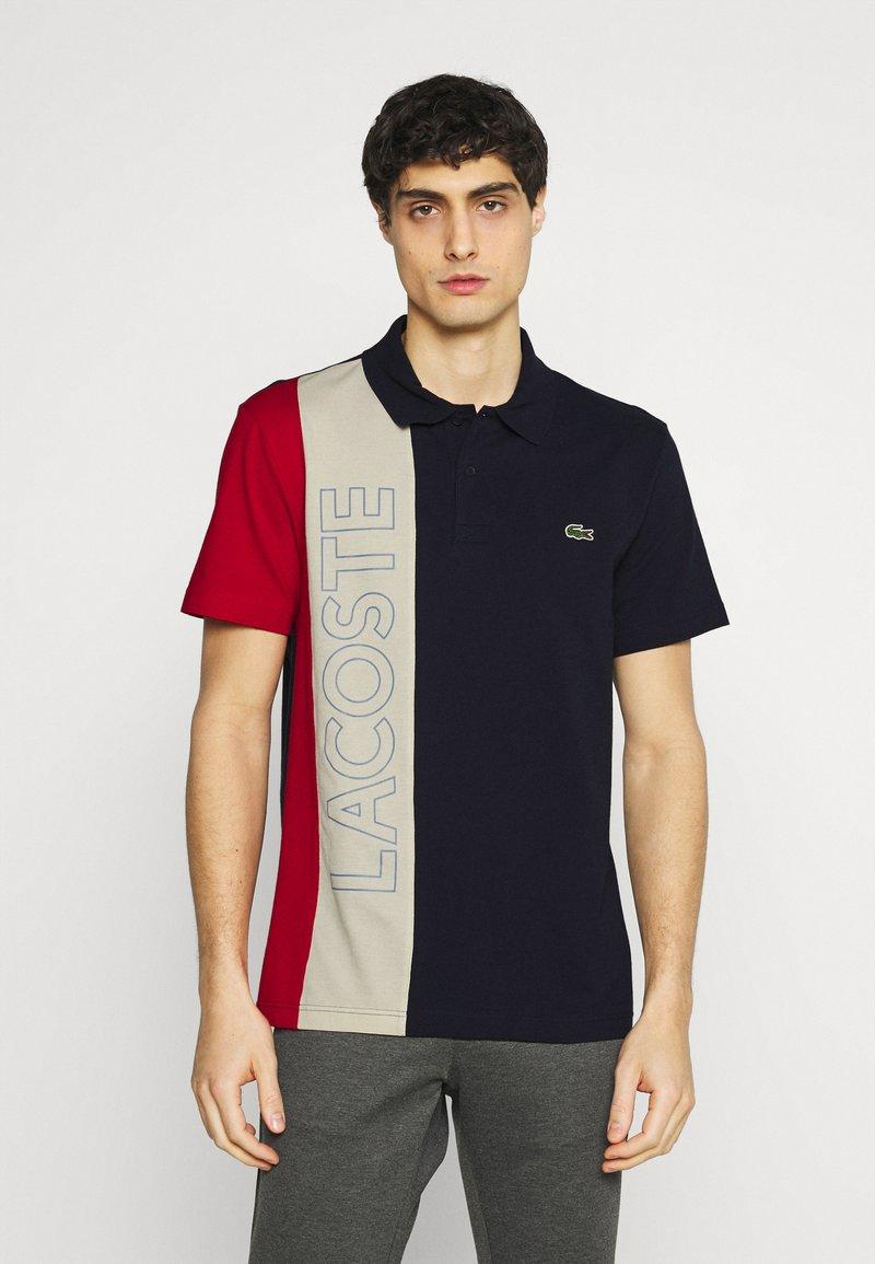 Lacoste - Poloshirt - marine/naturel clair/rouge