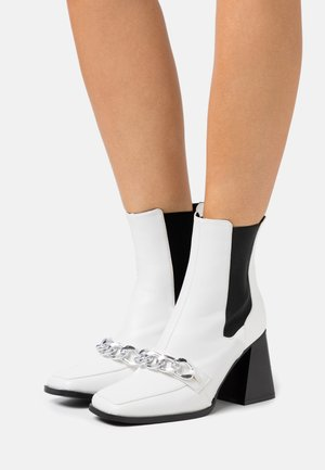 BEATRIX - High heeled ankle boots - white