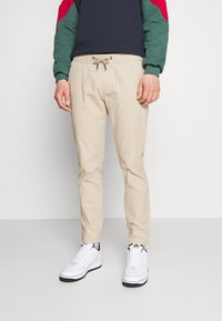 Tommy Jeans - SCANTON DOBBY TRACK PANT - Trousers - soft beige - 0