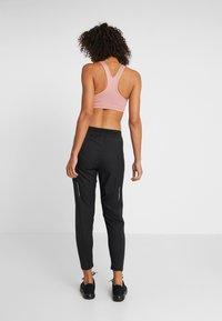 Nike Performance - Tracksuit bottoms - black/reflective silver - 2