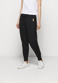 Polo Ralph Lauren - FEATHERWEIGHT - Tracksuit bottoms - black - 0