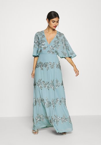 WRAP FRONT ALL OVER EMBELLISHED CAPE MAXI DRESS