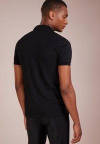 BOSS - PAULE SLIM FIT - Polo shirt - black - 2