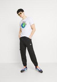 Puma - GRAPHIC TEE - Print T-shirt - white - 1