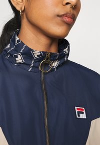 Fila - HARINI JACKET - Summer jacket - black iris/irish cream - 6