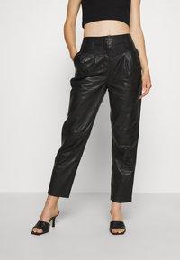 Topshop - ELLA  - Leather trousers - black - 0