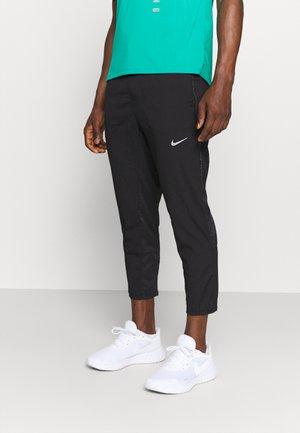 RUN PANT - Pantaloni sportivi - black/silver