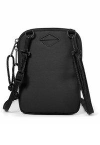 Eastpak - BUDDY  - Across body bag - black - 3