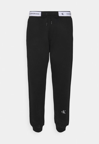 TAPE TRACK PANT - Verryttelyhousut - black