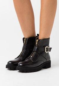 Steve Madden - JACKY - Platform ankle boots - black - 0