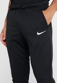 Nike Performance - Tracksuit bottoms - black/white - 4