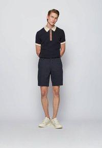 BOSS - HOLOMBO - Polo shirt - dark blue - 1