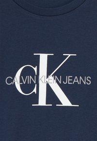 Calvin Klein Jeans - MONOGRAM LOGO UNISEX - T-shirt print - blue - 3