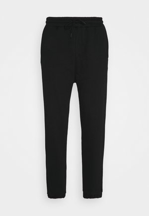 TAPERED TRACK - Tracksuit bottoms - black