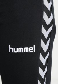 Hummel - AUTHENTIC CHARGE  - Tracksuit bottoms - black - 4