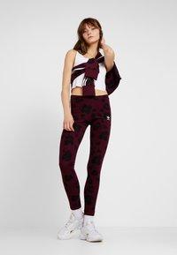 adidas Originals - BELLISTA ALLOVER PRINT PULLOVER - Sweatshirt - maroon/black - 1