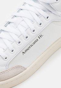 adidas Originals - AMERICANA SPORTS INSPIRED MID SHOES UNISEX - Zapatillas altas - footwear white/glory blue/core black - 5