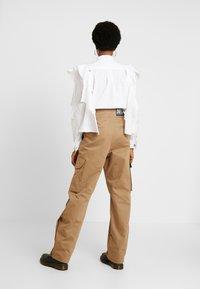 Diesel - CHIKU - Spodnie materiałowe - beige - 3