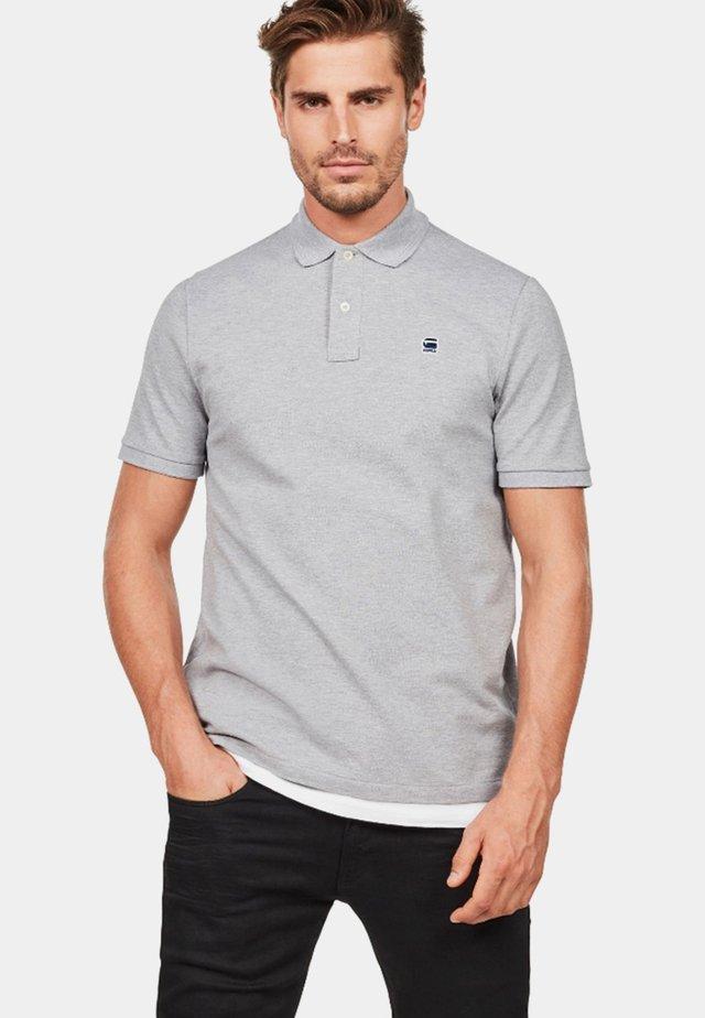 DUNDA - Polo shirt - grey
