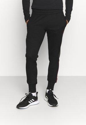 JJIWILL ZSTRIPE PANTS - Træningsbukser - black