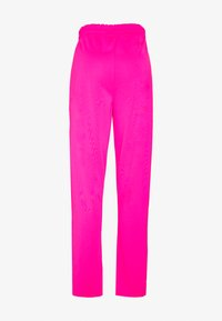 Missguided - PLAYBOY SPLIT STRAIGHT LEG TROUSERS - Pantalones deportivos - pink - 1