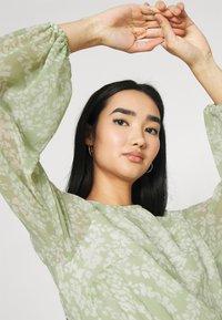 Gina Tricot - AMBER PLEATED DRESS - Day dress - green - 3