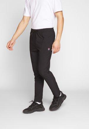 TAMAS - Teplákové kalhoty - black