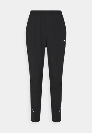 RUN TAPERED PANT - Pantalones deportivos - black